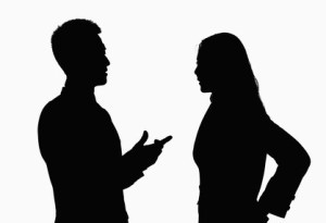 Silhouette of a leader and employee discussing performance problems