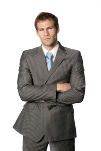 Defensive man standing with arms crossed