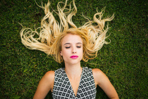 Young blonde woman summer day relaxing