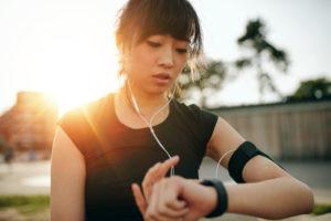 Woman monitoring her progress on smartwatch