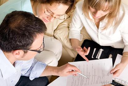 three-people-going-over-paperwork.jpg