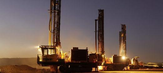 Ausdrill-drill-rigs-at-night-e1503540885