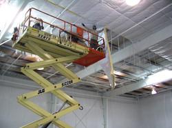 Crew Installing Strap Insulation System.