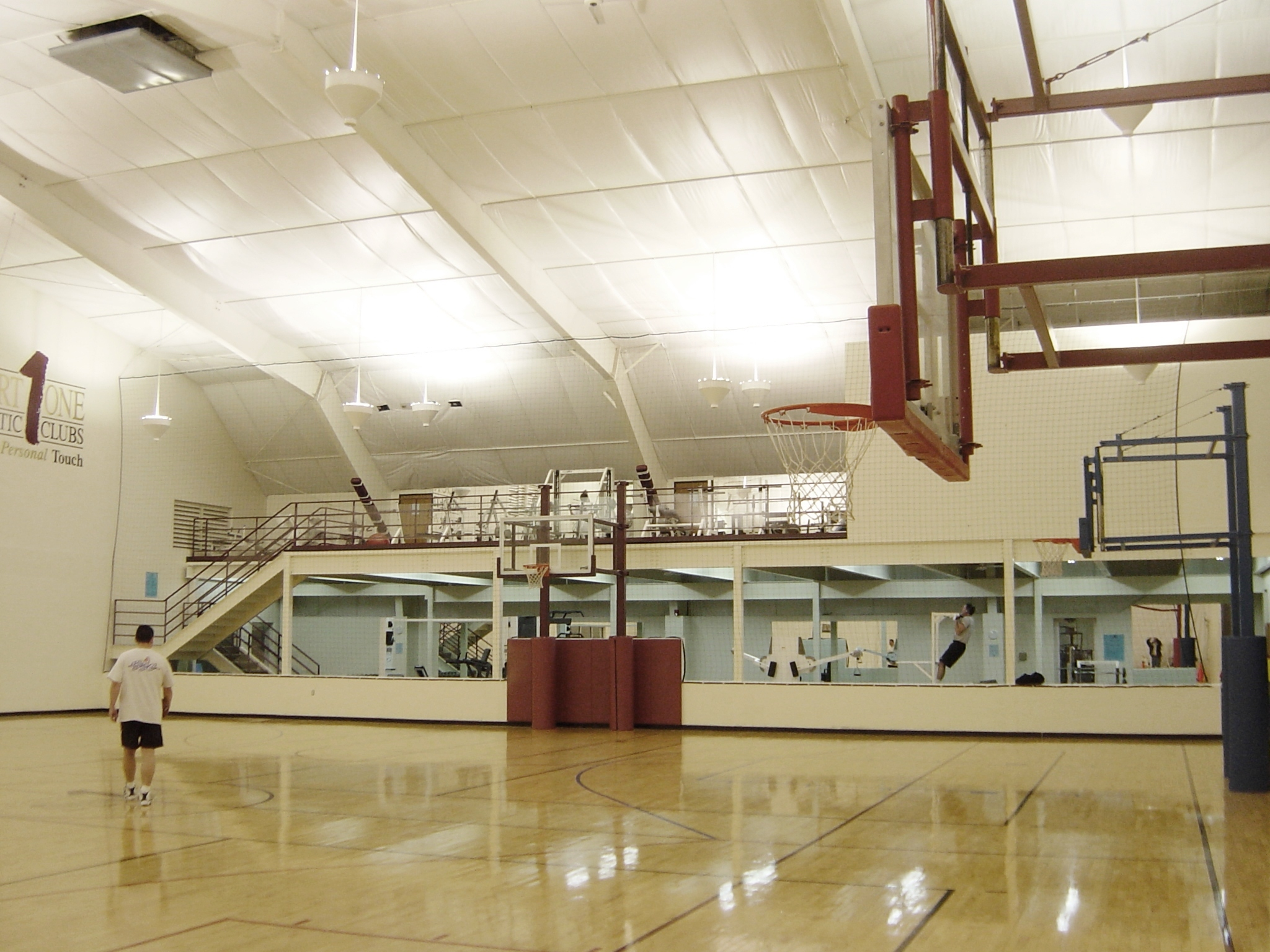 Court One East Gym Removed Tennis Courts and Built Out Fitness with Mezzanine & Basketball Courts