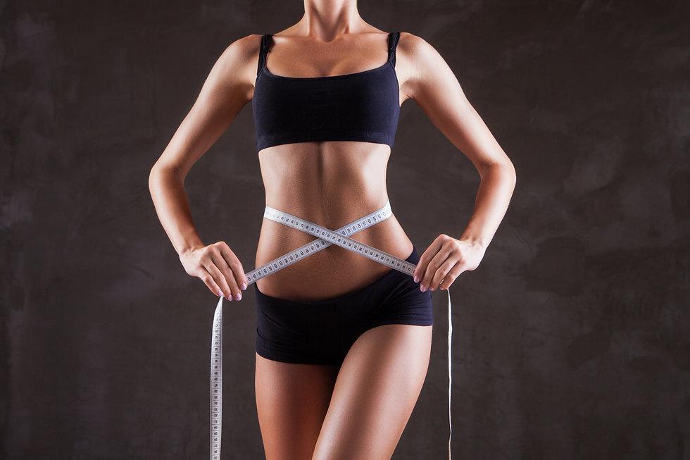 Woman mesuring her waist.jpg