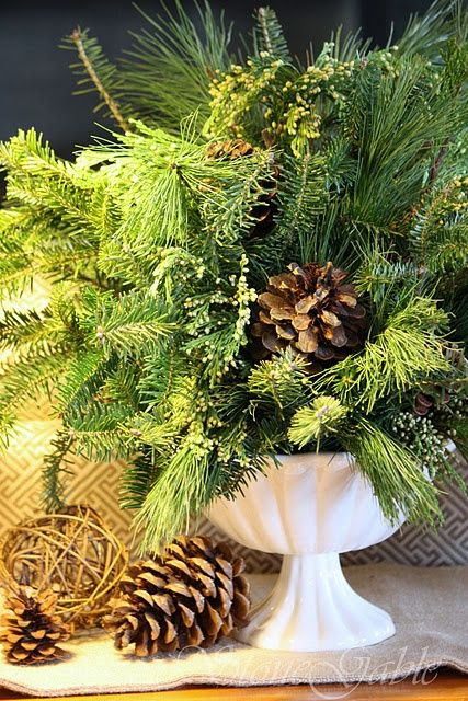 pinecones and greenery in bowl decoration