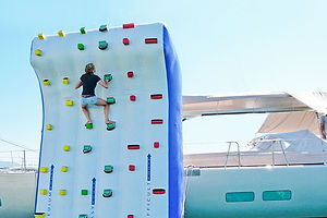 Reaching the top of the inflatable climbing, you'll find a refreshing splash at the bottom!