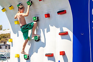 Choose your difficulty level and race to the top of the Aquaglide climbing wall