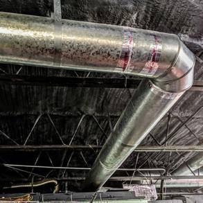 spray foam in metal ceiling with paint