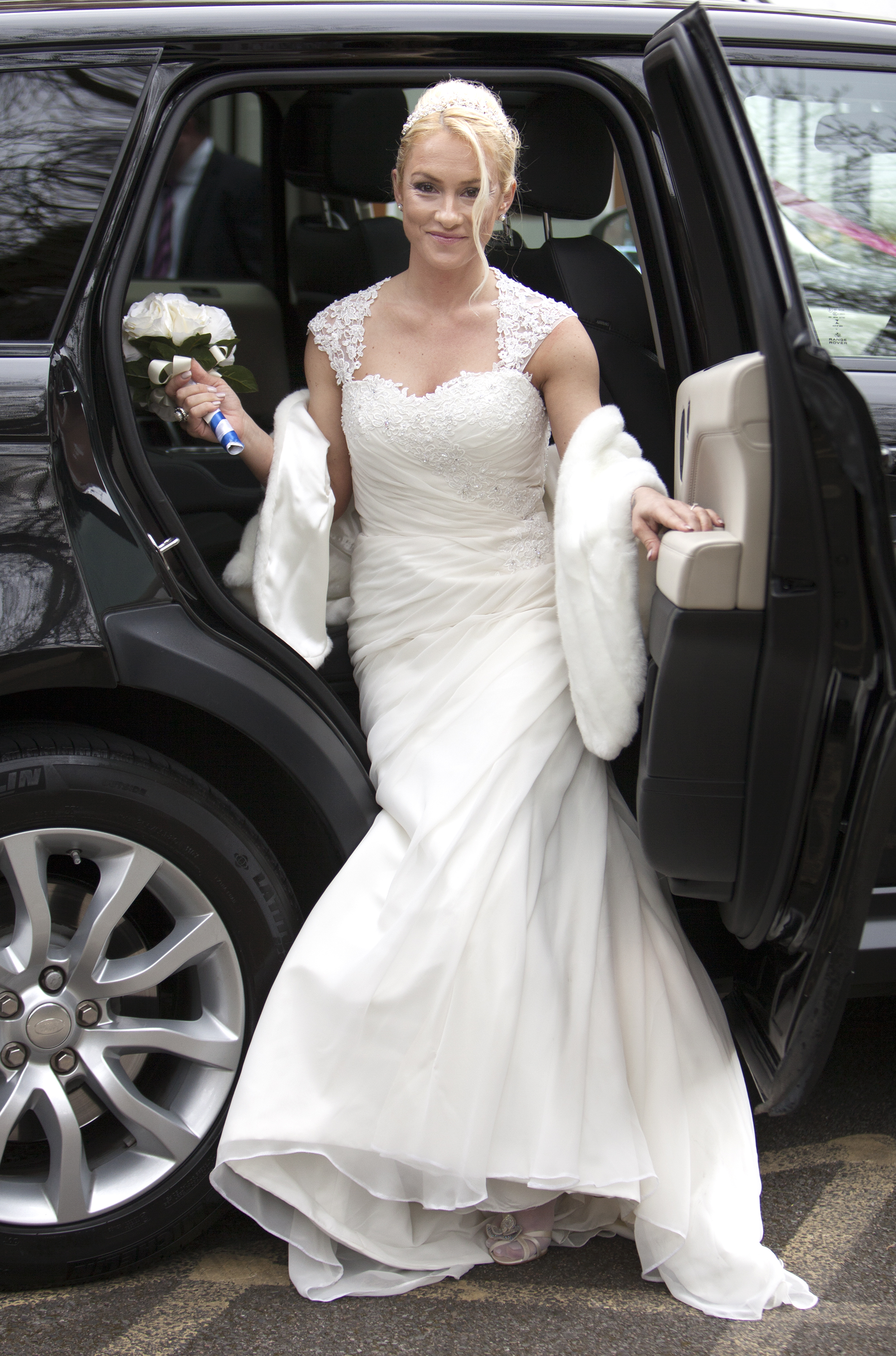 Beautiful bride getting out of car