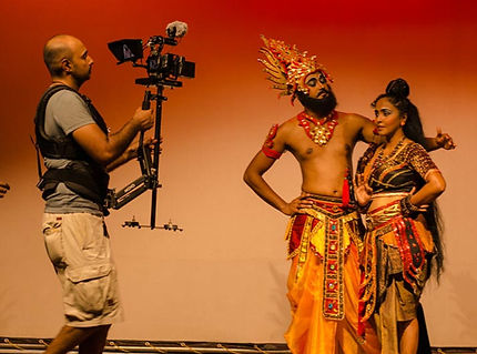 Cameraman films a couple in traditional Sri Lankan costumes