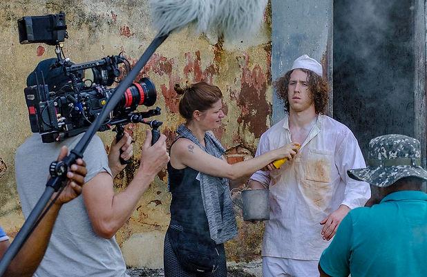 Kris Saddler dressed as a prisoner filming locked up abroad in Sri Lanka. Fixer Sri Lanka.