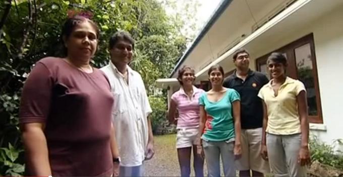 The De Zylva family standing outside their house in Colombo, Sri Lanka