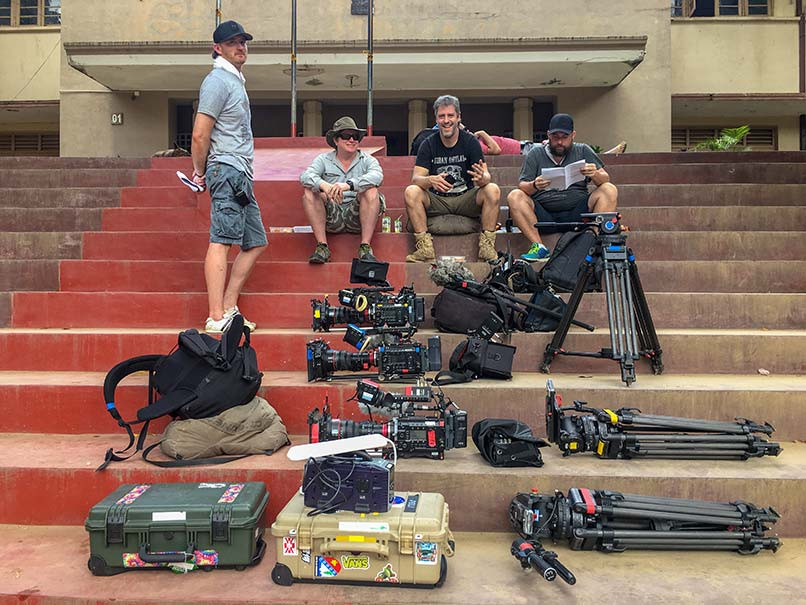 Three Sony F55 cameras and equipment on steps. BBC Top Gear Crew sitting.