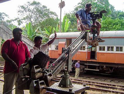 Cameraman on a track dolly crane