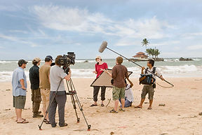 TV crew on a beach filming in Sri Lanka. Documentary filming.