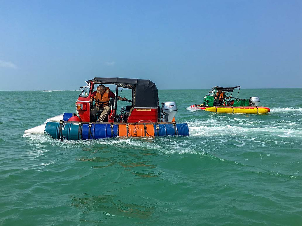Two Tuk Tuk motorboats being sailed on the sea. Matt Leblanc, Chris Harris.