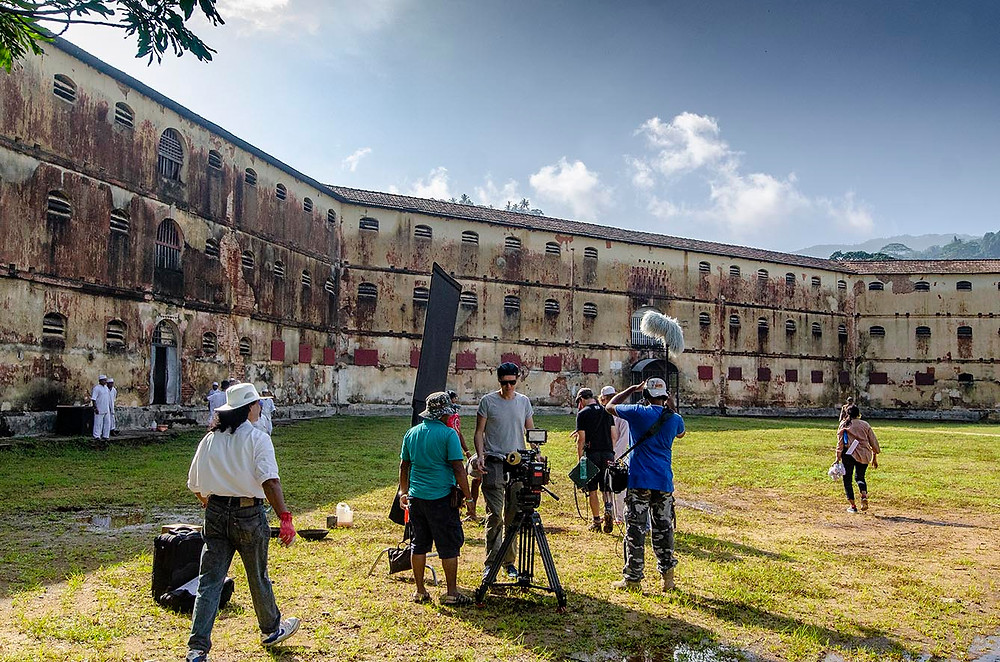 Film crew at work with the Bogambara prison in the background. Kandy, Sri Lanka.