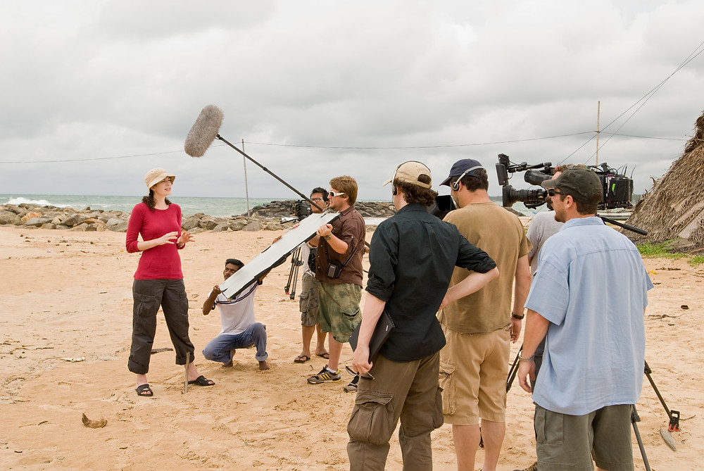 Dr. Kara Cooney being filmed on a beach in Hikkaduwa, Sri Lanka