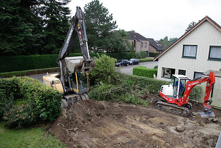 excavator and mini-digger clearing garden for landscaping