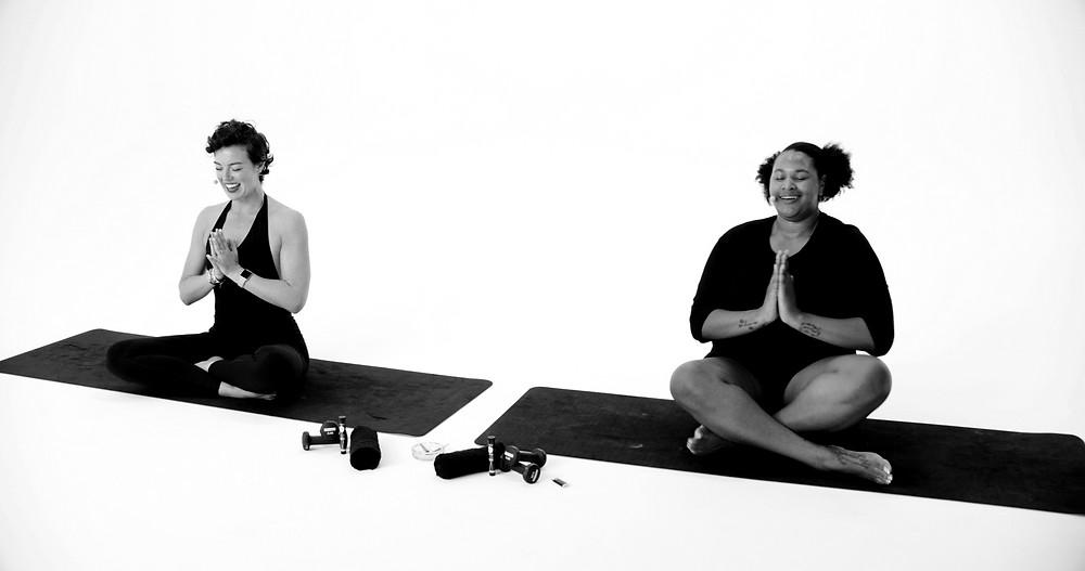 Two women in yoga pose