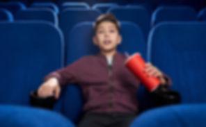 strained-boy-watching-horror-movie-cinem