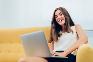 woman-sitting-sofa-with-laptop-legs_23-2