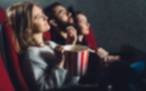 people-with-popcorn-enjoying-movie_23-21