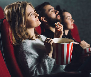 people-with-popcorn-enjoying-movie_23-21