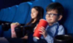 joyful-kids-watching-movie-drinking-fizz