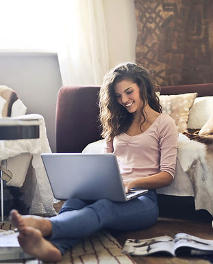 Canva - Woman Smiling While Using Laptop