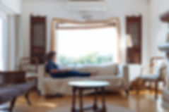 Canva - Woman Sitting on Sofa in Living
