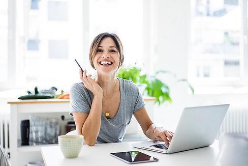canva HAPPY WOMAN AT COMPUTER.jpg