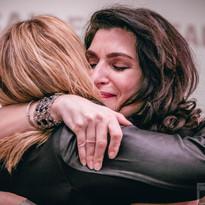 Donna + Marsh Hugging on Stage.jpg