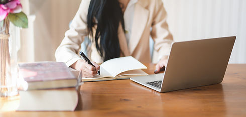 Canva - Woman Writing on Notebook.jpg