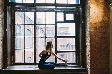 Canva - Woman Stretching Beside Window.j