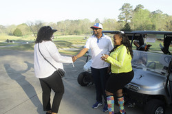 Pamela Parker, CEO Swing Into Their Dreams Foundation greeting Golfers