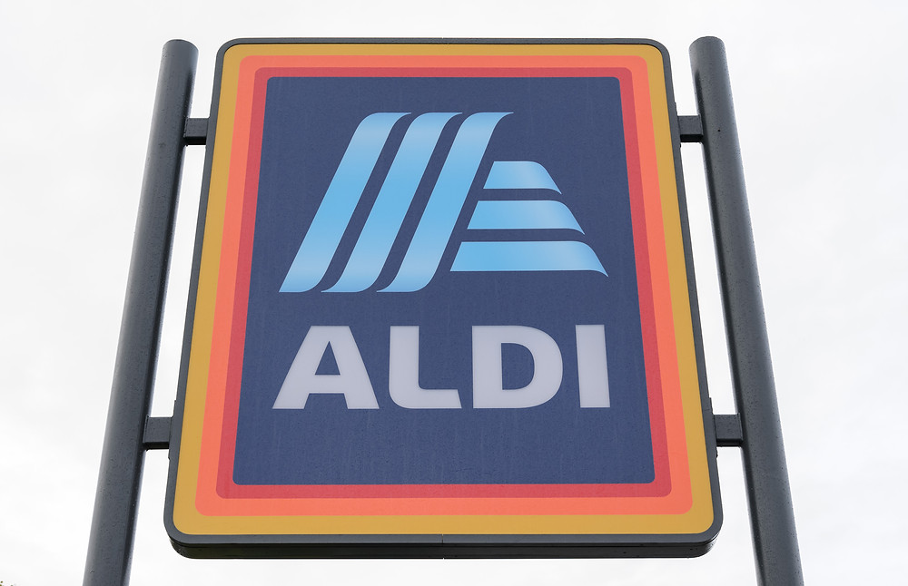 Aldi will stop offering single-use plastic bags in 100 stores in a trial which could save 109 tonnes of plastic a year if rolled out nationwide.