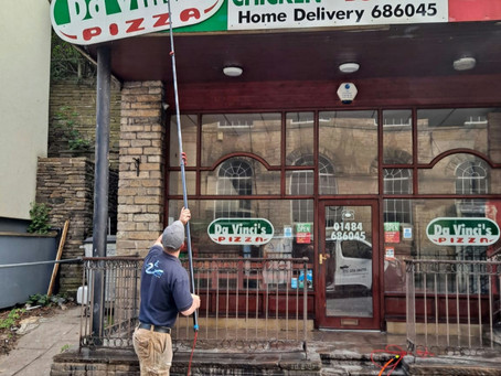 Cleaning Shop signage in Holmfirth