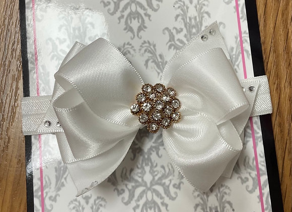 White headband with gold centre