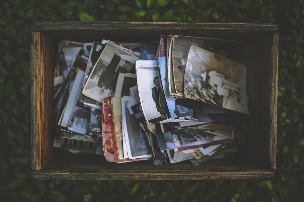 box of old pictures for dementia patient