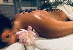 Woman recieving a hot stone massage spa service