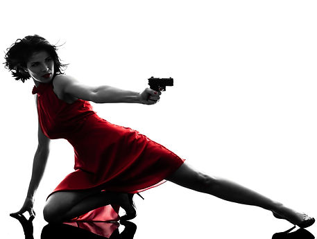beautiful woman in red dress with gun