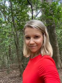 Red shit blond woman before boudoir portrait shoot