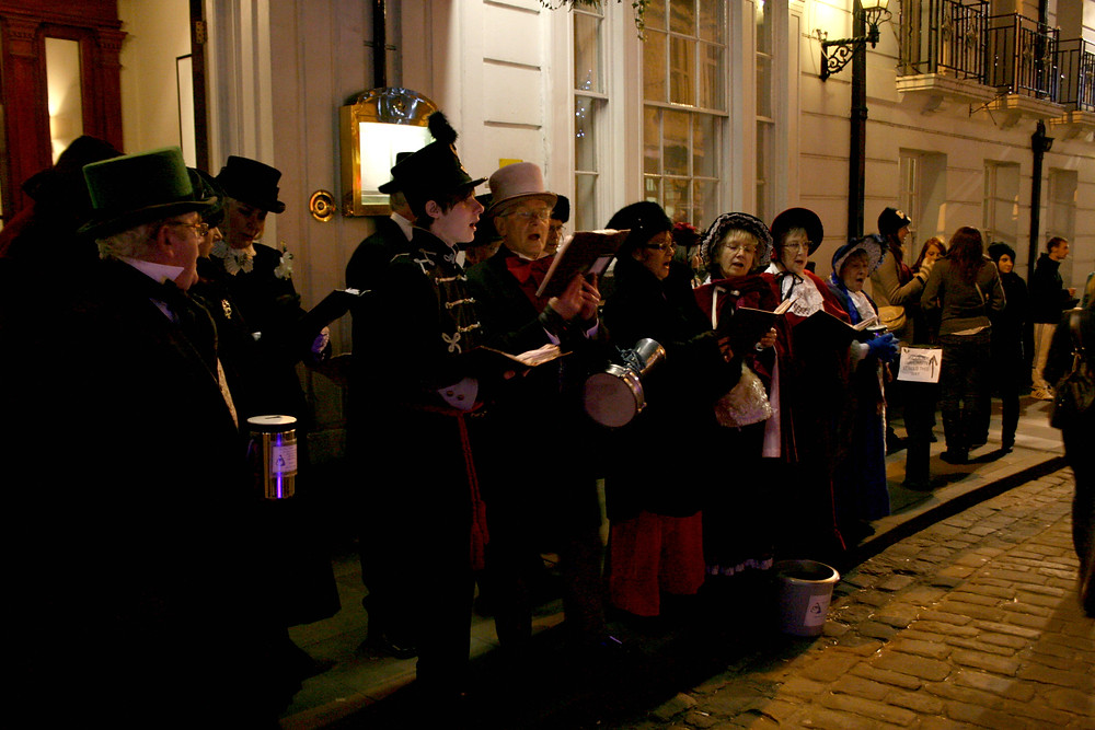 Christmas carolers performing on a street