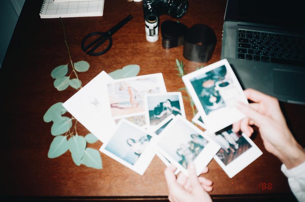 https://www.canva.com/photos/MADxglAS29c-person-holding-instant-photos/