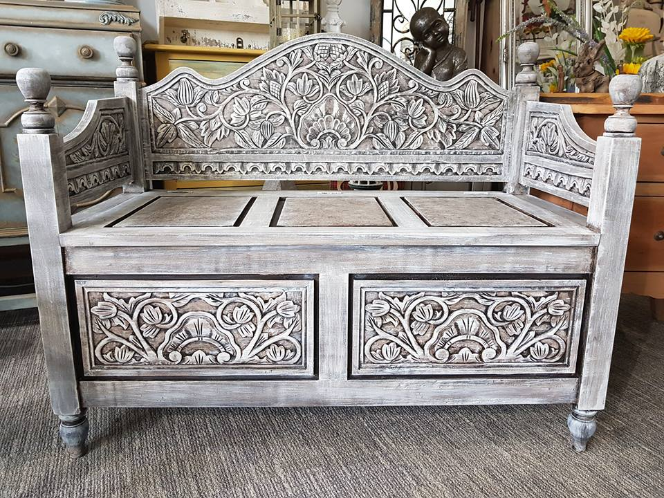 carved bench with storage
