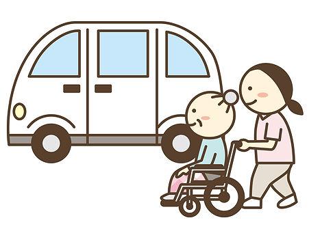 介護職員と車いす