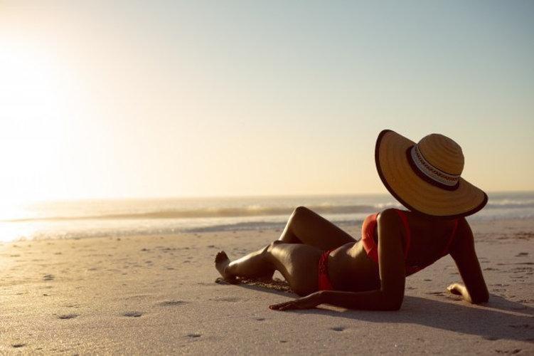 woman-hat-relaxing-beach.jpg