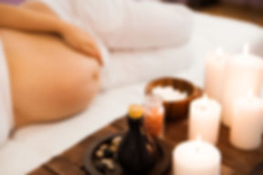 Young pregnant woman relaxing at Spa sal